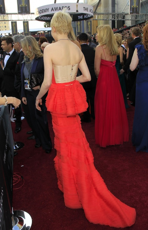 Michelle Williams Oscar 2012 coral Louis Vuitton back.jpg